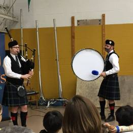 Angus (left) and Chris Eller (right) performing at the LotusBlossoms Bazaar at Binford Elementary School on April 1, 2017.